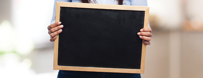 Picture of hands holding a blackboard