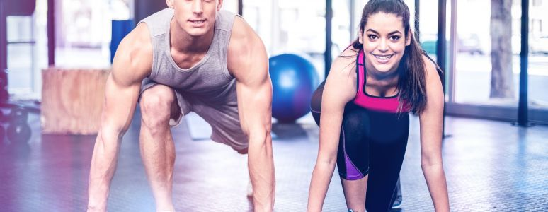 Man and woman in gym doing exercise
